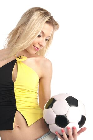 Beautiful young female with a soccer ball isolated on the white background. Stock Photo - 6088966
