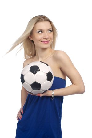 Beautiful young female with a soccer ball isolated on the white background. photo
