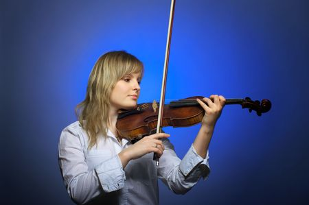 Cute young female violinist at the classical concert photo