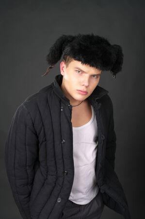 waif: Young russian man in the fur cap with ear-flaps Stock Photo