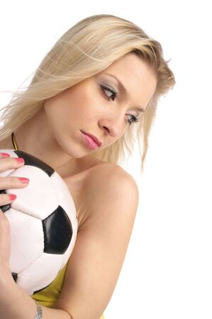 Closeup portrait of cute blond girl with a soccer ball isolated on the white background. photo