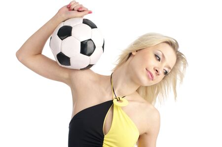 Cute fashion girl with a soccer ball isolated on the white background. Stock Photo