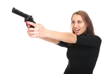Beautiful young woman with a gun isolated over white background photo