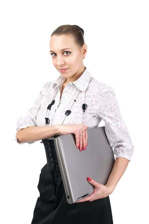 Young attractive businesswoman holding laptop over white background photo