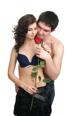seductive couple: Beutiful sexual couple with red rose isolated over white background Stock Photo
