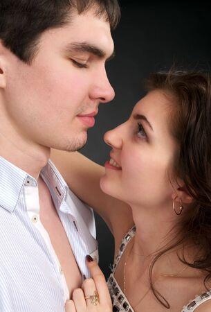 Portrait of embracing beautiful sexual couple over black Stock Photo - 6402723