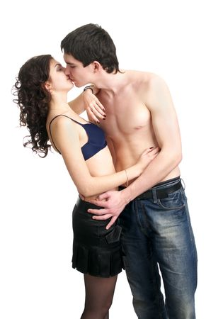 Beautiful sexual semi-dressed couple kissing isolated over white background