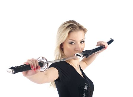 sheath: Beautiful woman in aggressive posture getting a sword on the white background