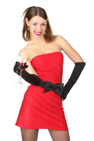 Cute cheerful female in little red dress with glass of wine. Isolated over white background photo