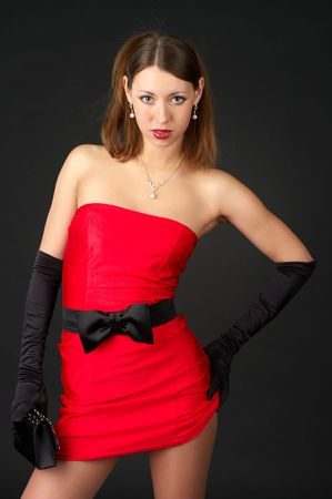 Beautiful young woman lift up her little red dress Stock Photo - 6657275