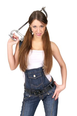 overall: Attractive young woman in overalls holding handsaw, isolated over white background. Stock Photo
