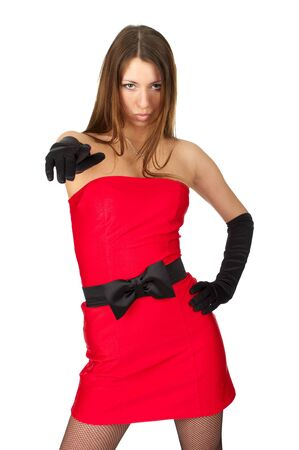 Beautiful girl in little red dress pointing at you Stock Photo - 6680341