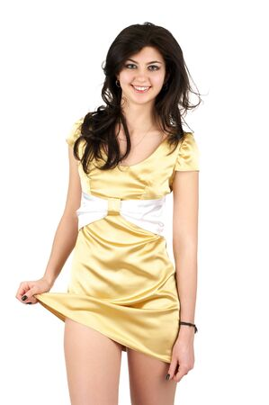 Beautiful young woman in little yellow silk dress isolated over white background photo