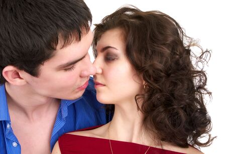Portrait of kissing beautiful sexual couple isolated over white background photo