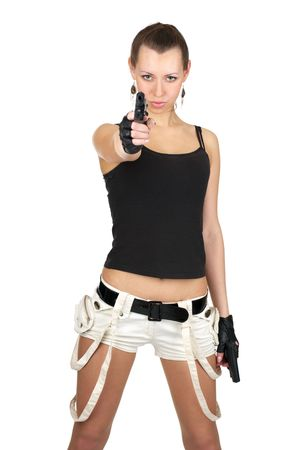 Sexy female with two guns aiming to you, isolated over white background photo