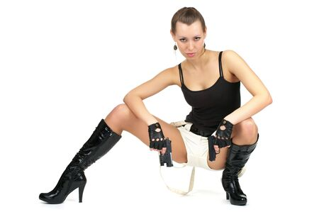 squatting: Attractive female sitting with two guns isolated over white Stock Photo