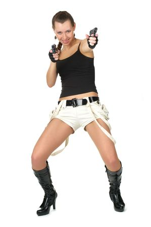 Attractive female with two small handguns isolated over white photo