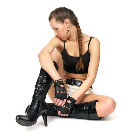 downcast: Beautiful sad fetish girl with handcuffs sitting at the floor Stock Photo