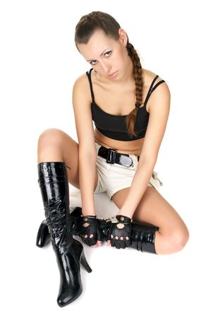 Attractive sad handcuffed girl sitting at the white floor photo