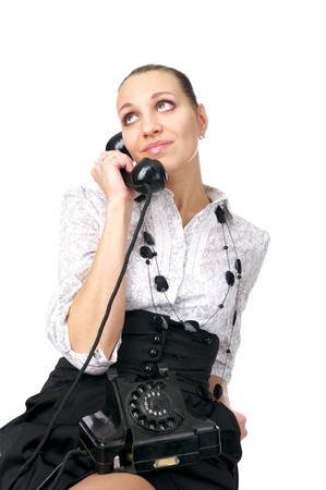 Cute female operator talking old-style phone over white background photo