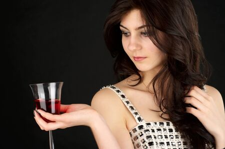 Beautiful young woman with glass of red wine over black background Stock Photo - 6925981