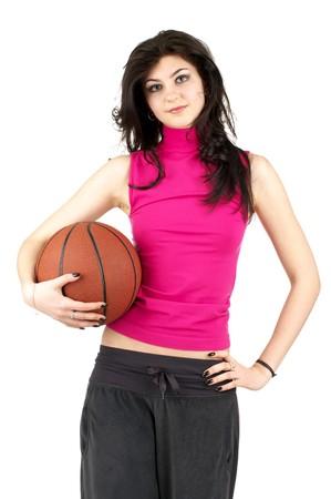 Lindos mujeres jóvenes en uniforme de deportes sosteniendo el baloncesto Foto de archivo - 6978420