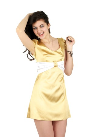 Beautiful cheerful woman in little yellow silk dress isolated over white background photo