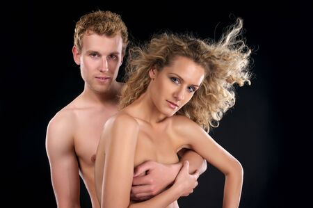 naked couple: Beautiful naked couple with curly hair over black background Stock Photo
