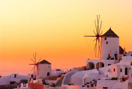 Amazing sunset at Oia village in Santorini island. photo