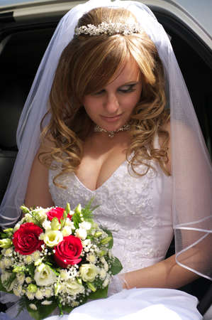 Portrait of the bride sitting in the car Stock Photo - 8098649
