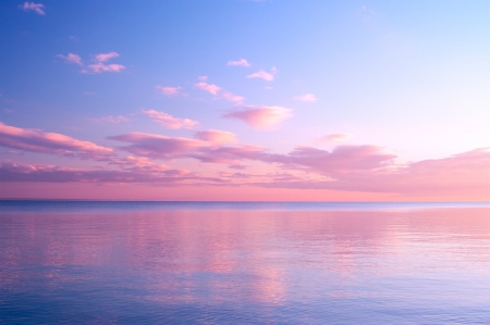 Twilight Dusk. Beautiful clouds over the calm sea. Stock Photo