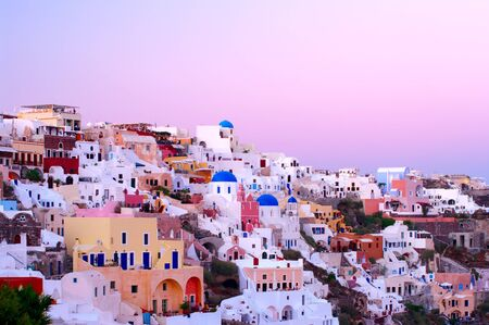 Oia village buildings in the evening light Stock Photo