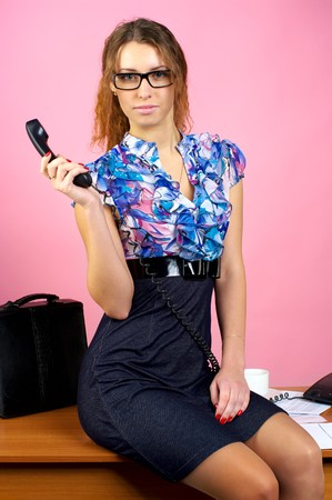 Attractive business woman in the pink office photo