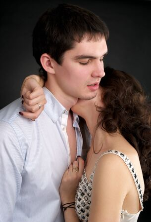 sexual couple: Portrait of embracing beautiful sexual couple over black