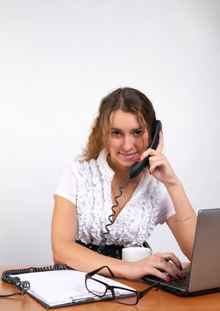 Cute business woman talking phone in the office photo