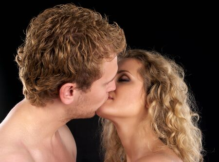 Beautiful young couple kissing, black background Stock Photo - 8253926