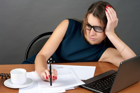 Young businesswoman tired of work photo