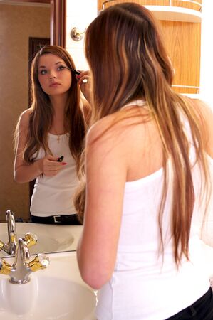 Beautiful young woman during daily morning routines photo