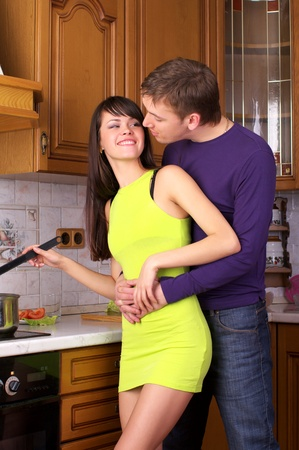 married together: Portrait of a happy young couple preparing healthy food together at home Stock Photo