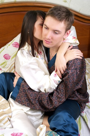 Young couple sharing a passionate moment together photo