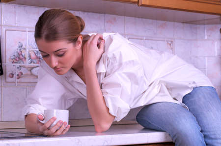 Sensual female is drinking coffee in the kitchen Stock Photo - 8851608