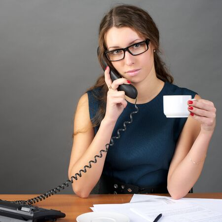 Portrait of businesswoman talking phone in the office photo