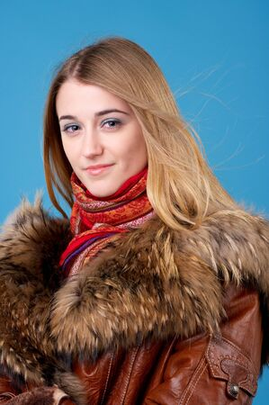 sheepskin: Portrait of beautiful female in sheepskin coat with fur collar Stock Photo