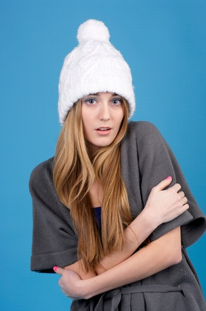 Portrait of beautiful freezing woman in winter hat photo