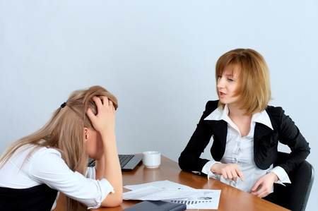 Female executive rebukes secretary in the office