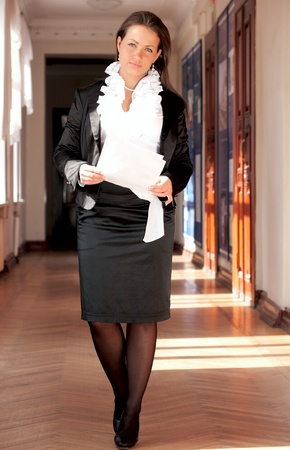 Beautiful confident businesswoman walking through a corridor