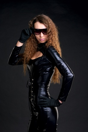 Portrait of sexy woman in skintight latex and sunglasses Stock Photo