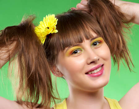 tresses: Portrait of cheerful girl holding her hairs in tresses