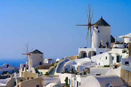 santorini greece: Traditional windmills in the Santorini island, Greece. Stock Photo