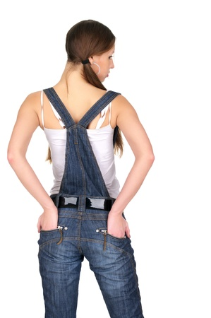 Back view of woman in denim overalls over white background Stock Photo - 10038174